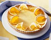 An orange and vanilla tart with icing sugar
