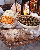 Side dishes for Thanksgiving: wild rice stuffing, mashed potatoes and mashed sweet potatoes (USA)