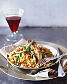 Pork chops with tomato rice and green beans