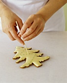 Decorating a Christmas Tree Shaped Sugar Cookie