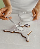 Decorating a Reindeer Shaped Christmas Cookie with Sugar