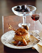 Whole Quail Cooked in Puff Pastry with Fig Sauce; Glass of Wine