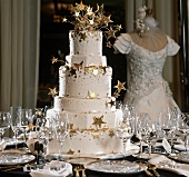 Tiered Wedding Cake with Gold Stars on a Set Table