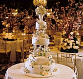 A Wedding Cake Decorated with Flowers on a Round Table