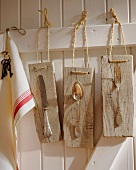 Old silver cutlery on wooden boards