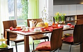 Easter breakfast on a dining table, table and chairs made from walnut wood