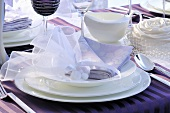 A festively decorated place setting with packets of sweets