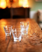 Glasses of water on a rustic wooden table