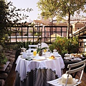 Breakfast outside - a table laid on a Southern roof terrace