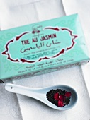 A box and a spoonful of jasmine tea