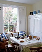 A comfortable dining room by a window in a country house