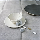 An empty tea cup and tea bags