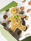 A gingerbread man in a box