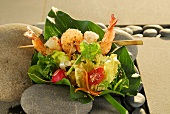 Salad leaves with prawn skewer and Asian dressing
