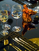 Place-setting with wine glasses