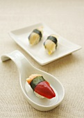Nigiri sushi made with shellfish (hokkigai) & mackerel (saba)