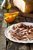 Parma ham, sliced, with melon wedges