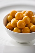 Cape gooseberries in white bowl