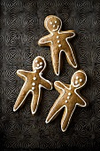 Three gingerbread men (overhead view)