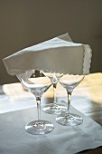 Three wine glasses covered with a napkin