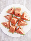 Pieces of watermelon on plate from above