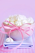 Meringues in a bowl with a bow