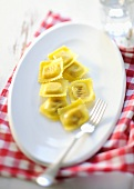 Ravioli on plate with fork
