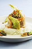 Salmon trout with savoy cabbage and lentils on rice