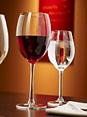 Glass of red wine and glass of water on table in restaurant