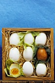 Hard-boiled eggs in wooden box