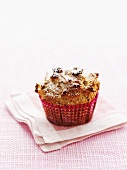 Apple and cranberry muffin with icing sugar