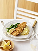 Chicken escalope with mashed potato, green beans and lemon