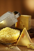 Emmental cheese, whole and grated