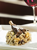A leg of lamb on a bed of risotto