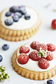 Strawberry tartlets and blueberry tartlets