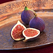 Red figs in a copper bowl