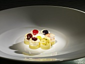 Fruit pralines with white chocolate (molecular gastronomy)