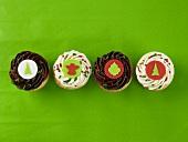 Four Christmas cupcakes