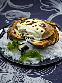 Grilled crab on a bed of salt