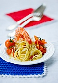 Spaghetti with cherry tomatoes and king prawns
