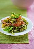 Green tagliatelle with Prosciutto and pumpkin strips