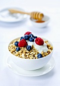 A bowl of muesli with fresh berries and yogurt