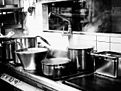 Steaming pots in a restaurant kitchen