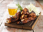 Pork ribs with coleslaw and beer