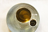 Mulberry tea in a glass cup, seen from above