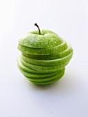 A sliced Granny Smith apple