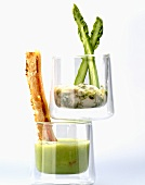Cream of asparagus soup with a bread stick