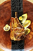 Veal chop with chicory and lemon confit