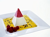 Parfait pyramid with fruit sauce and raspberries