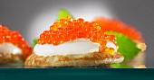 Blinis with creme fraiche and chum salon caviar